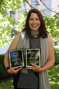 Rebecca Wilson-Mah with awards